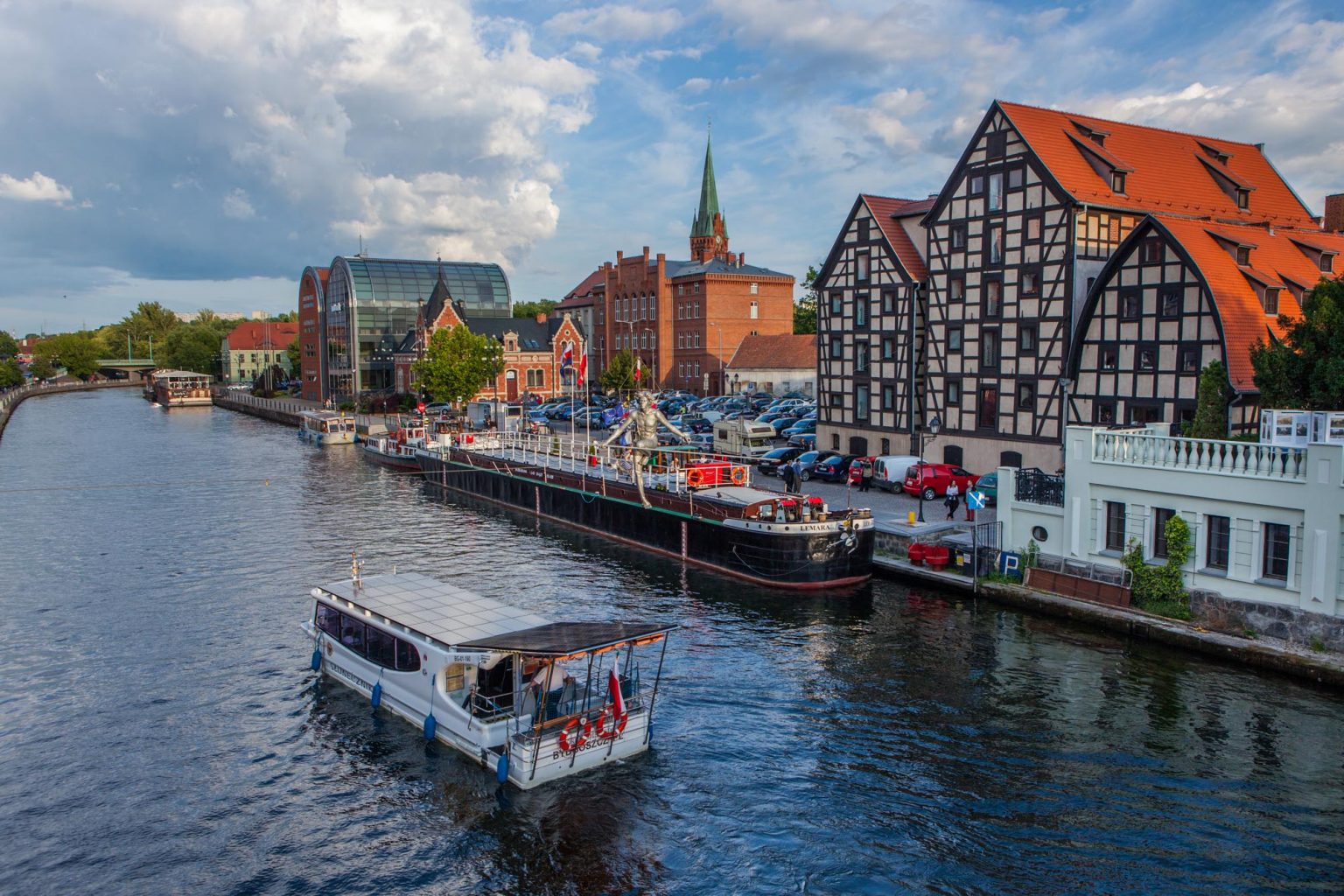 granaries in Bydgoszcz with barge and watertram