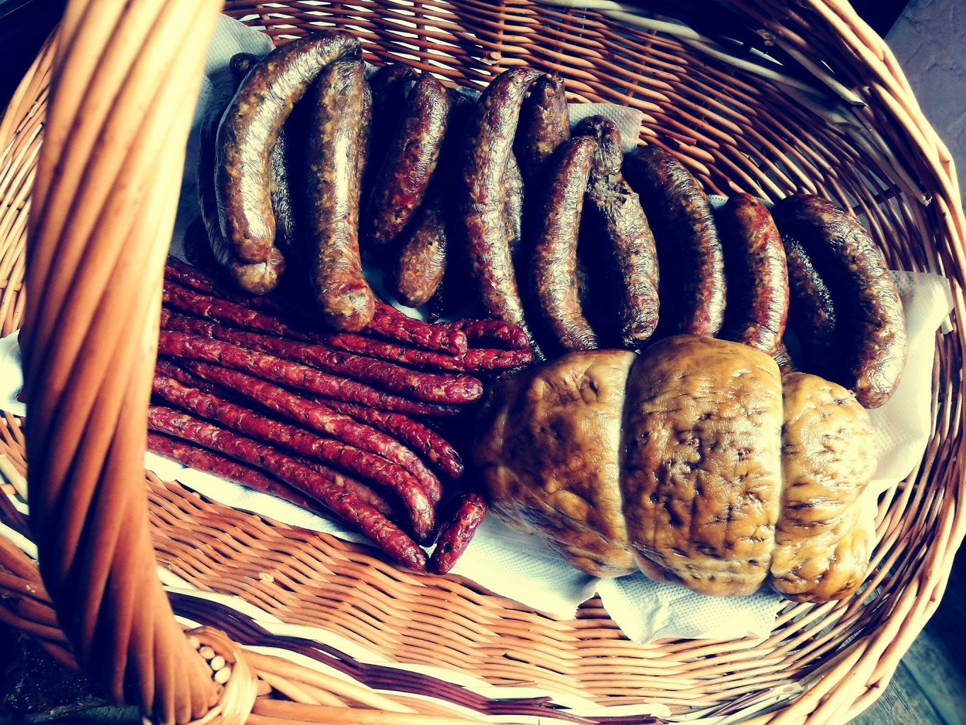basket wit home made sausages on the local farmers market in bydgoszcz