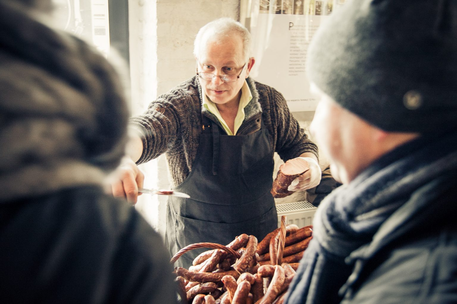 stall with meat and sausages on the local farmers market in bydgoszcz
