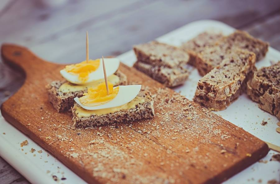 rye bread with egg on the wooden board, local farmers market in bydgoszcz