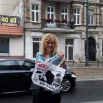 guide daria with a gift bag from US visitors on dworcowa street in bydgoszcz
